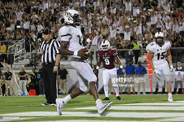 Justin Holman of the UCF Knights scores a touchdown during a NCAA football game against the South Carolina State Bulldogs at Bright House Networks...