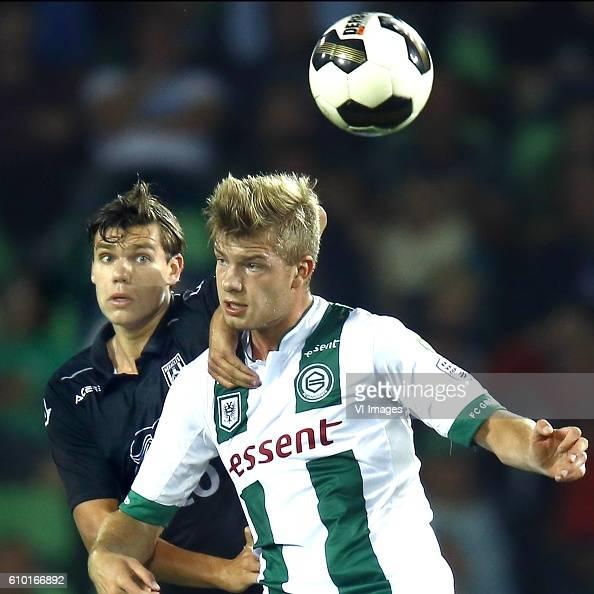 Justin Hoogma of Heracles Almelo Alexander Sorloth of FC Groningen during the Dutch Eredivisie match between FC Groningen and Heracles Almelo at...