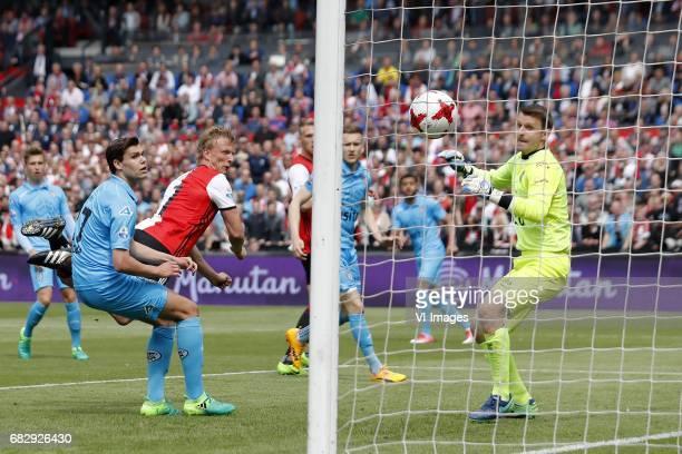 Justin Hoogma of Heracles Almelo Dirk Kuyt of Feyenoord Mike te Wierik of Heracles Almelo Brandley Kuwas of Heracles Almelo goalkeeper Bram Castro of...
