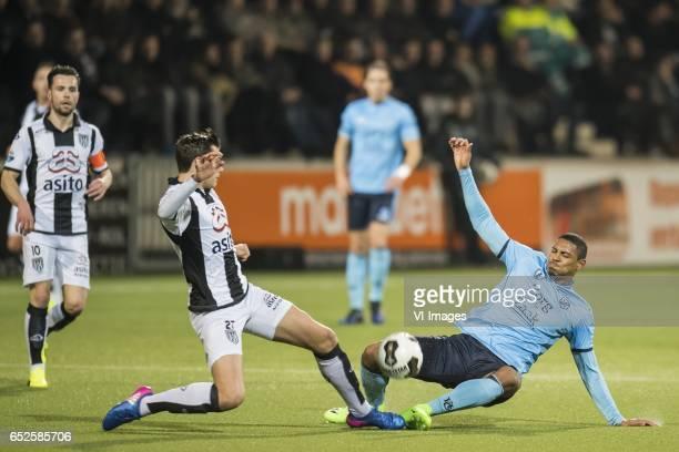 Justin Hoogma of Heracles Almelo Sebastien Haller of FC Utrechtduring the Dutch Eredivisie match between Heracles Almelo and FC Utrecht at Polman...