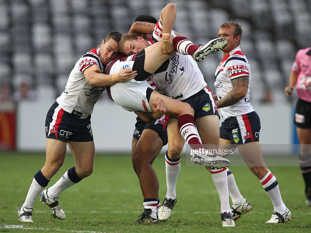 Justin Horo of the Sea Eagles is dumped by the Manly defence during the NRL trial match between the Manly Sea Eagles and the Sydney Roosters at Bluetongue Stadium on February 16, 2013 in Gosford, Australia.