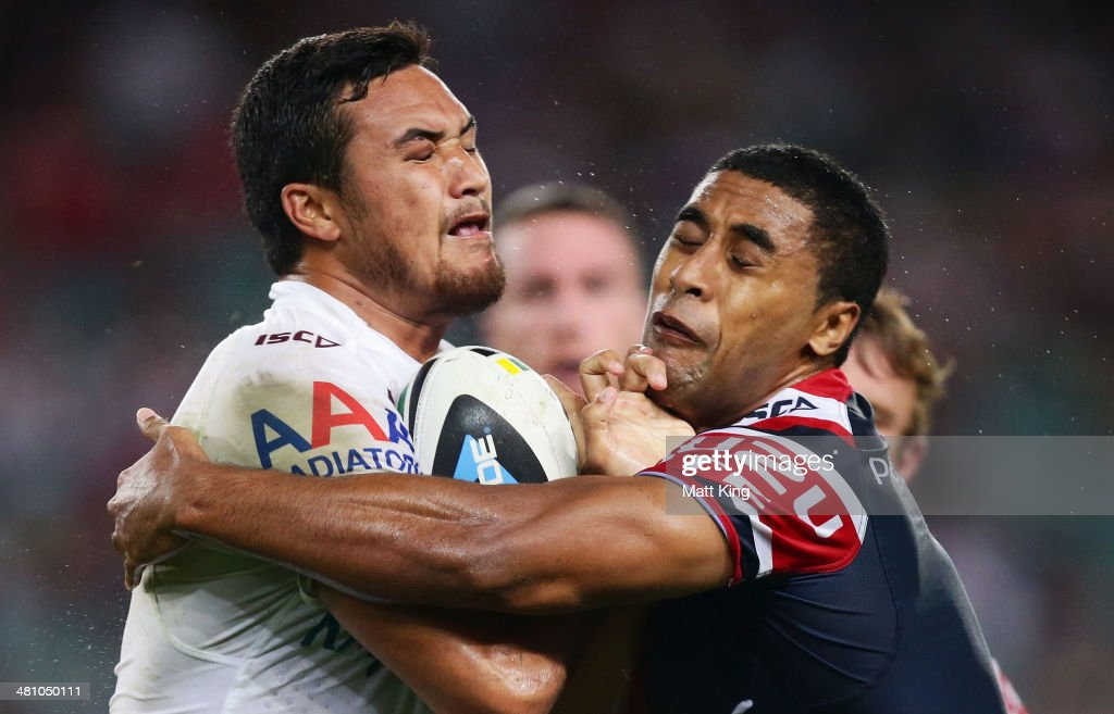 Justin Horo of the Sea Eagles is tackled by Michael Jennings of the Roosters during the round four NRL match between the Sydney Roosters and the Manly-Warringah Sea Eagles at Allianz Stadium on March 28, 2014 in Sydney, Australia.