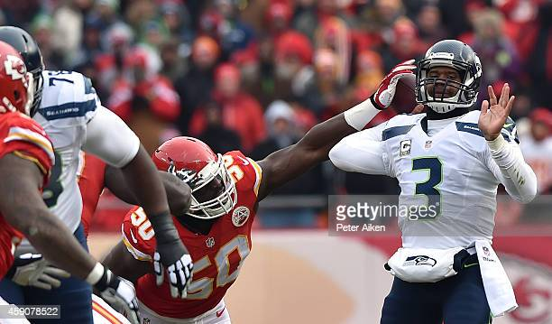 Justin Houston of the Kansas City Chiefs forces a fumble on Kansas City Chiefs Russell Wilson of the Seattle Seahawks during the first half at...