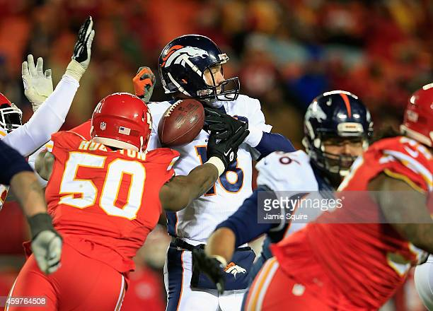 Justin Houston of the Kansas City Chiefs forces a fumble on Peyton Manning of the Denver Broncos during the third quarter at Arrowhead Stadium on...