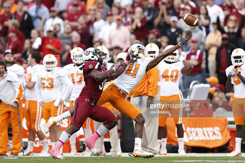 Justin Hunter #11 of the Tennessee Volunteers tries to make a reception against D.J. Swearinger #36 of the South Carolina Gamecocks during the game at Williams-Brice Stadium on October 27, 2012 in Columbia, South Carolina. South Carolina won 38-35.