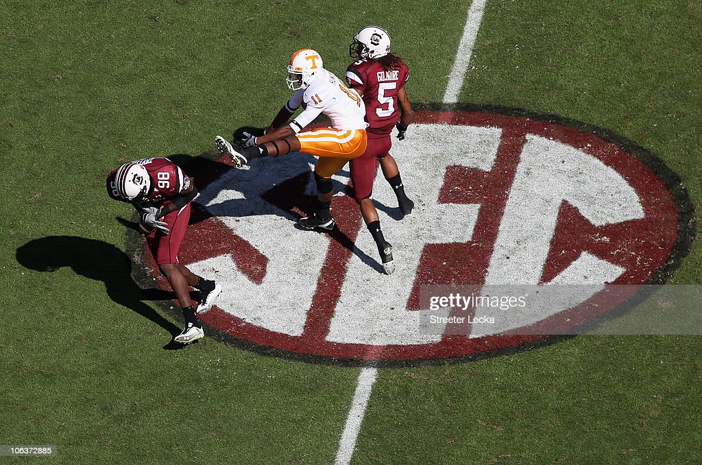 Justin Hunter #11 of the Tennessee Volunteers watches as Devin Taylor #98 of the South Carolina Gamecocks makes an interception during their game at Williams-Brice Stadium on October 30, 2010 in Columbia, South Carolina.