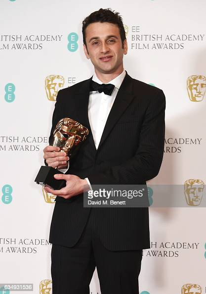 Justin Hurwitz winner of the Original Music award for 'La La Land' poses in the winners room at the 70th EE British Academy Film Awards at Royal...
