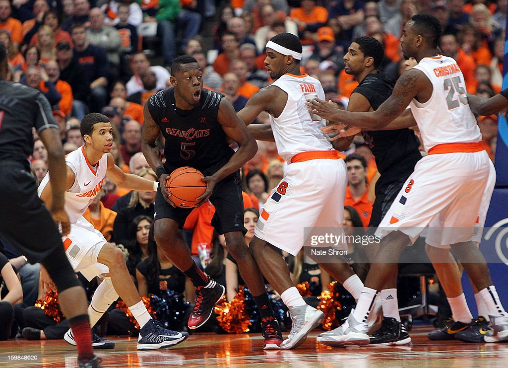 Justin Jackson #5 of the Cincinnati Bearcats attempts to pass the ball against Michael Carter-Williams #1, and C.J. Fair #5 of the Syracuse Orange during the game at the Carrier Dome on January 21, 2013 in Syracuse, New York.