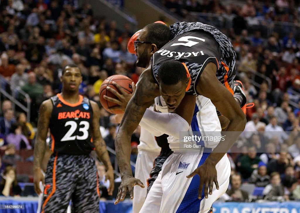 Justin Jackson #5 of the Cincinnati Bearcats fouls <a gi-track='captionPersonalityLinkClicked' href=/galleries/search?phrase=Gregory+Echenique&family=editorial&specificpeople=5648736 ng-click='$event.stopPropagation()'>Gregory Echenique</a> #00 of the Creighton Bluejays in the second half during the second round of the 2013 NCAA Men's Basketball Tournament on March 22, 2013 at Wells Fargo Center in Philadelphia, Pennsylvania.