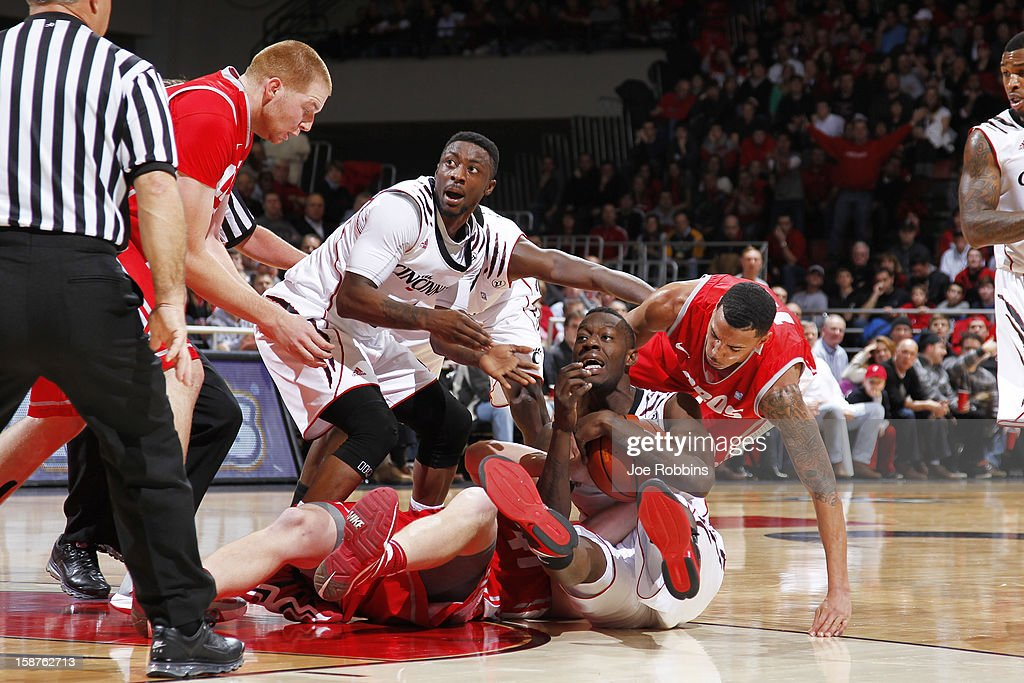 Justin Jackson #5 of the Cincinnati Bearcats tries to call for a timeout after diving to the floor for a loose ball against the New Mexico Lobos during the game at Fifth Third Arena on December 27, 2012 in Cincinnati, Ohio. New Mexico won 55-54.