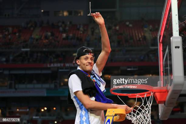 Justin Jackson of the North Carolina Tar Heels cuts the net after defeating the Gonzaga Bulldogs during the 2017 NCAA Men's Final Four National...
