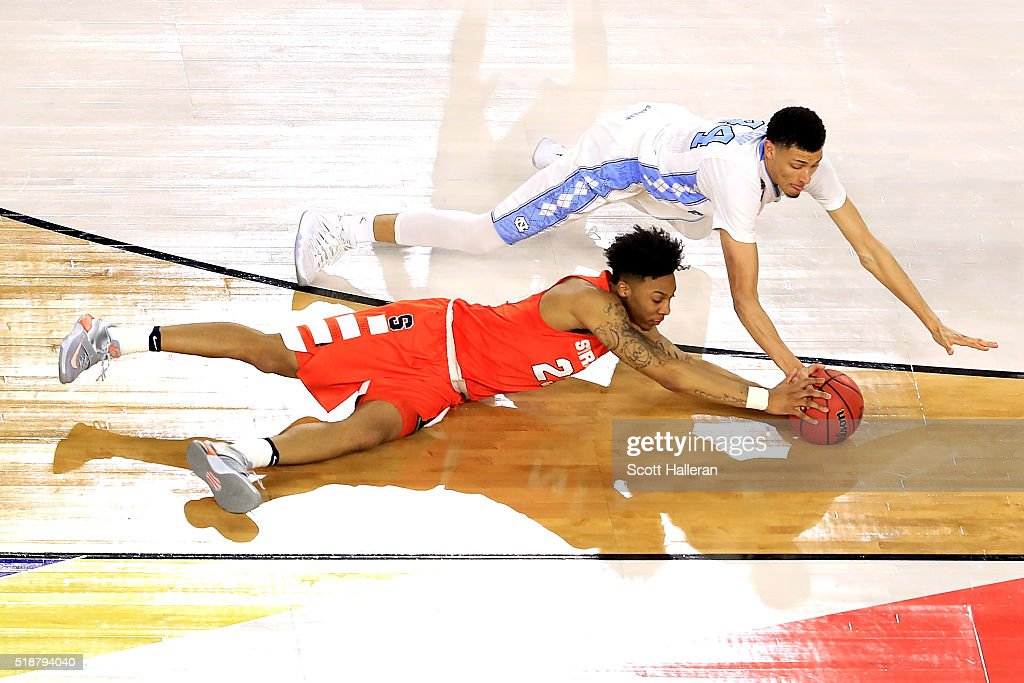 Justin Jackson of the North Carolina Tar Heels dives for a loose ball against Malachi Richardson of the Syracuse Orange in the second half during the...