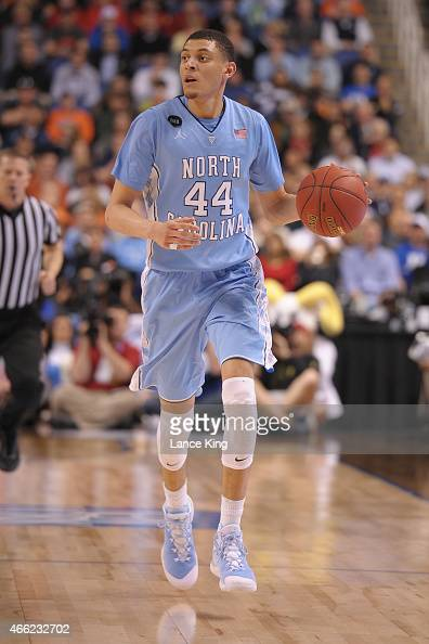 Justin Jackson of the North Carolina Tar Heels dribbles against the Virginia Cavaliers during the semifinals of the 2015 Men's ACC Tournament at the...