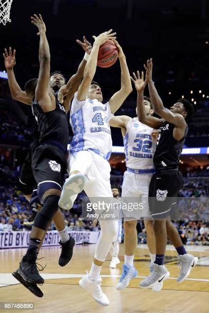 Justin Jackson of the North Carolina Tar Heels gets a rebound in the first half against the Butler Bulldogs during the 2017 NCAA Men's Basketball...