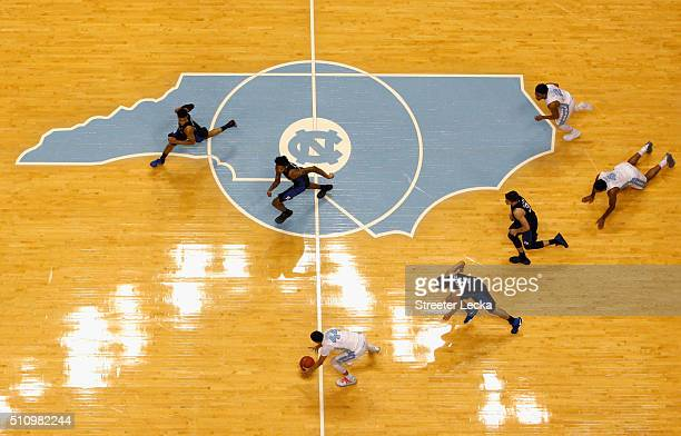 Justin Jackson of the North Carolina Tar Heels goes after a loose ball against the Duke Blue Devils during their game at Dean Smith Center on...