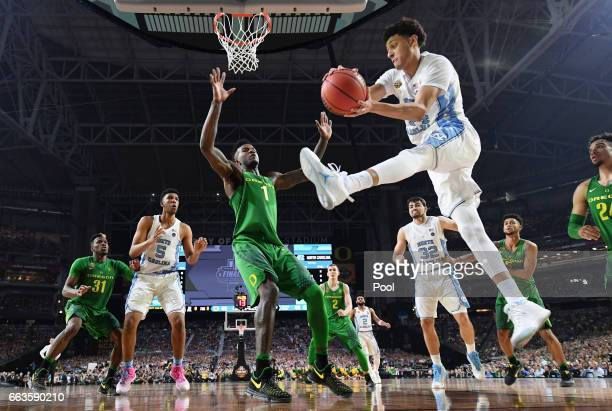 Justin Jackson of the North Carolina Tar Heels handles the ball against Jordan Bell of the Oregon Ducks in the second half during the 2017 NCAA Men's...
