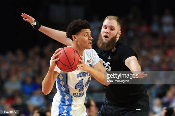 Justin Jackson of the North Carolina Tar Heels handles the ball against Przemek Karnowski of the Gonzaga Bulldogs in the first half during the 2017...