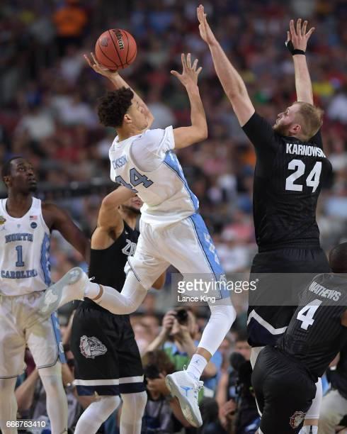 Justin Jackson of the North Carolina Tar Heels puts up a shot against Przemek Karnowski of the Gonzaga Bulldogs during the 2017 NCAA Men's Final Four...