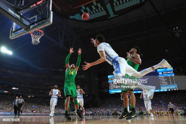 Justin Jackson of the North Carolina Tar Heels shoots against Dillon Brooks of the Oregon Ducks in the second half during the 2017 NCAA Men's Final...
