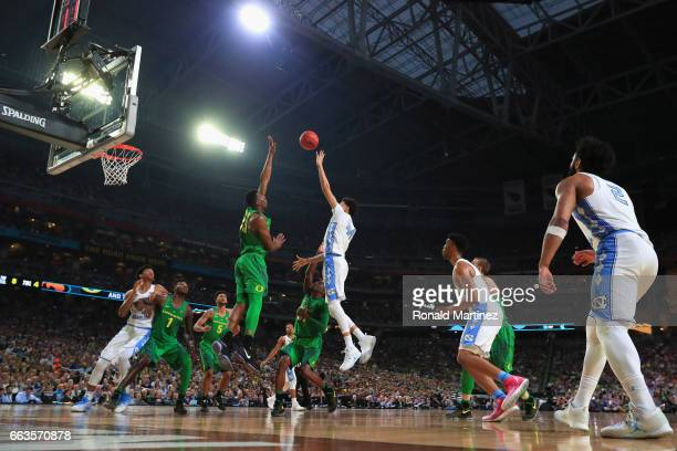 Justin Jackson of the North Carolina Tar Heels shoots against Kavell BigbyWilliams of the Oregon Ducks in the first half during the 2017 NCAA Men's...