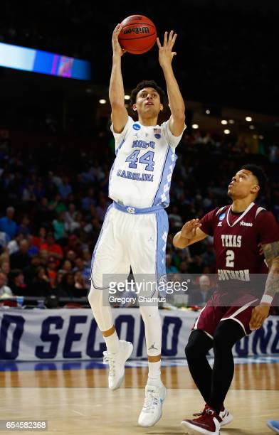 Justin Jackson of the North Carolina Tar Heels shoots against Zach Lofton of the Texas Southern Tigers in the first half during the first round of...
