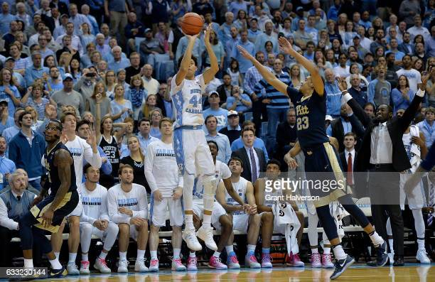 Justin Jackson of the North Carolina Tar Heels takes a threepoint shot against Cameron Johnson of the Pittsburgh Panthers during the game at the Dean...