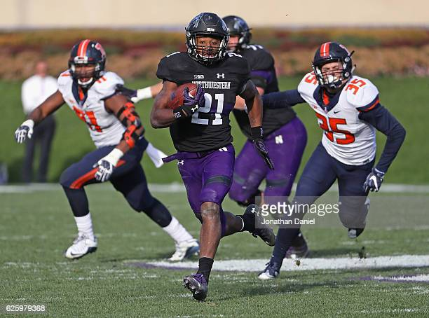 Justin Jackson of the Northwestern Wildcats breaks a long first down run as Jake Hansen of the Illinois Fighting Illini gives chase at Ryan Field on...