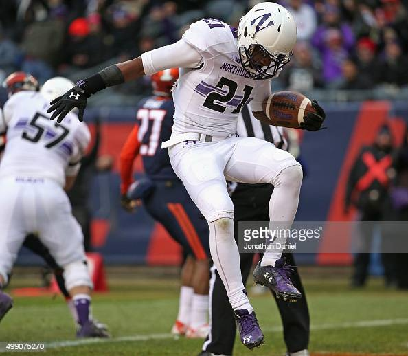 Justin Jackson of the Northwestern Wildcats leaps in celebration after scoring a touchdown against the Illinois Fighting Illini at Soldier Field on...