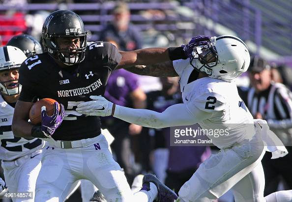 Justin Jackson of the Northwestern Wildcats stiffarms Marcus Allen of the Penn State Nittany Lions at Ryan Field on November 7 2015 in Evanston...