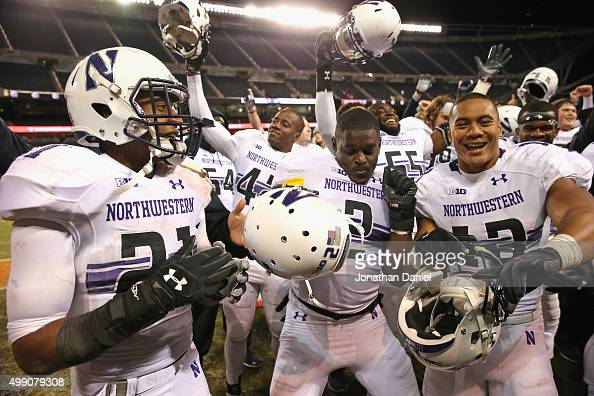 Justin Jackson Traveon Henry and Warren Long of the Northwestern Wildcats celebrate a win over the Illinois Fighting Illini at Soldier Field on...