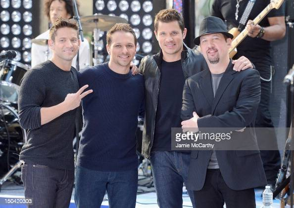 Justin Jeffre Drew Lachey Nick Lachey and Jeff Timmons of 98 Degrees performs on NBC's 'Today' at Rockefeller Plaza on August 17 2012 in New York City
