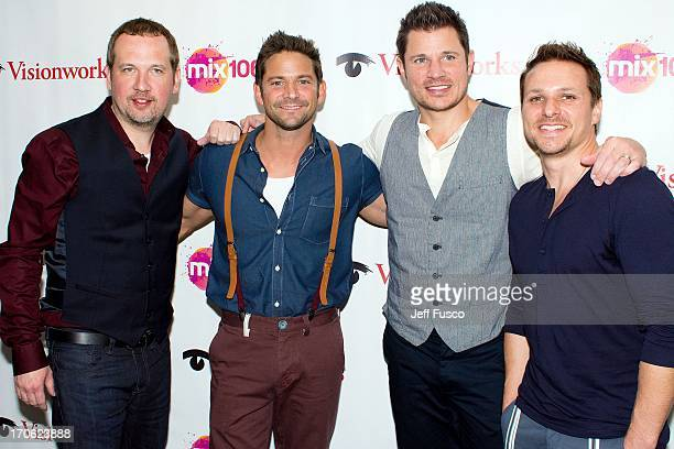Justin Jeffre Jeff Timmons Nick Lachey and Drew Lachey of 98 Degrees pose at the WISX Performance Theater on June 15 2013 in Bala Cynwyd Pennsylvania