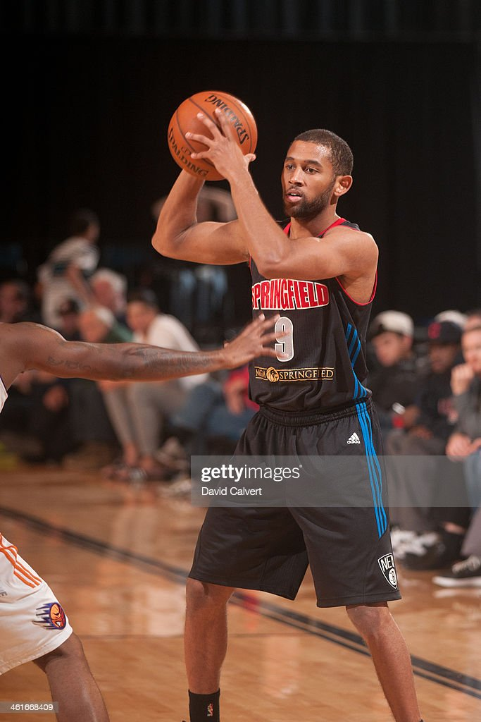 Justin Johnson #9 of the Springfield Armor looks to pass against the Iowa Energy during the 2014 NBA D-League Showcase on January 9, 2014 at the Reno Events Center in Reno, Nevada.