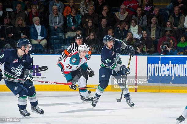 Justin Kirkland of Kelowna Rockets back checks Ethan Bear of Seattle Thunderbirds as he passes the puck up the ice on January 16 2015 at Prospera...