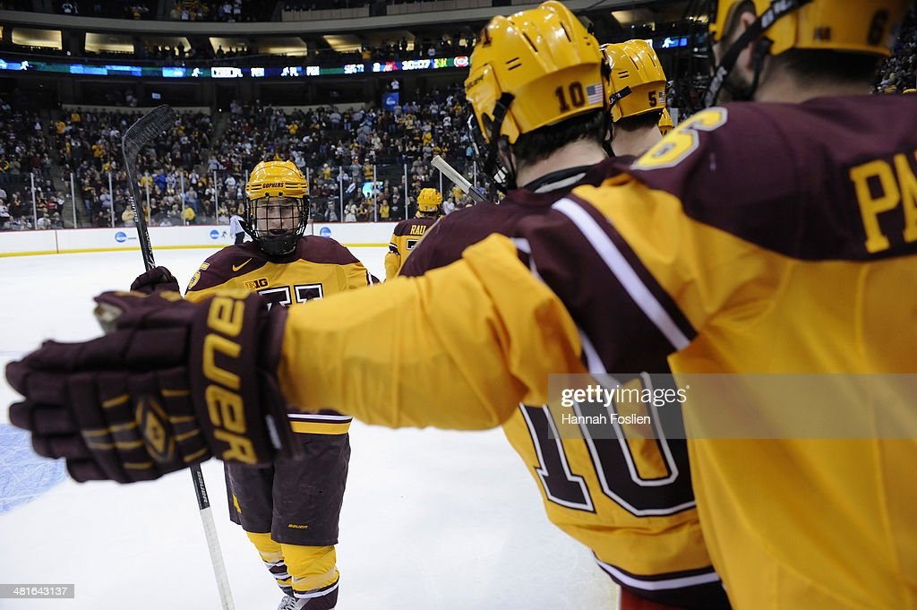 Justin Kloos #25 of the Minnesota Golden Gophers celebrates a goal against the St. Cloud State Huskies during the second period of the final game in the West Regional of the 2014 NCAA Division I Men's Ice Hockey Championship on March 30, 2014 at Xcel Energy Center in St Paul, Minnesota. The Minnesota Golden Gophers defeated the St. Cloud State Huskies 4-0.