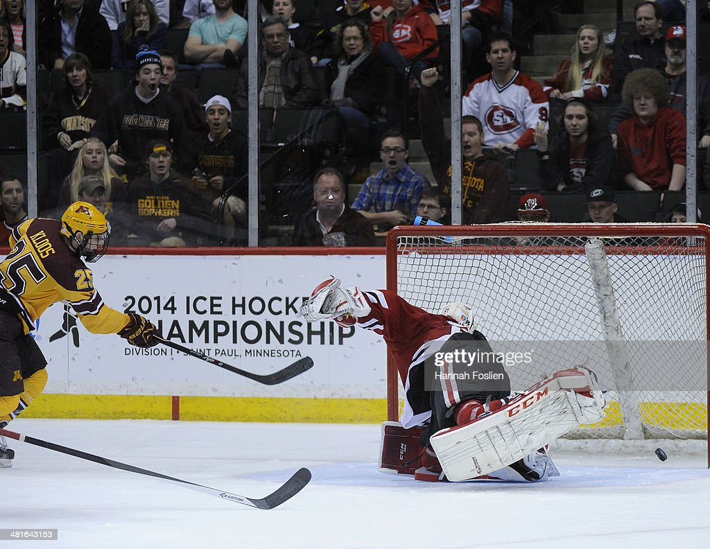 Justin Kloos #25 of the Minnesota Golden Gophers gets the puck past Ryan Faragher #29 of the St. Cloud State Huskies for a goal during the second period of the final game in the West Regional of the 2014 NCAA Division I Men's Ice Hockey Championship on March 30, 2014 at Xcel Energy Center in St Paul, Minnesota. The Minnesota Golden Gophers defeated the St. Cloud State Huskies 4-0.