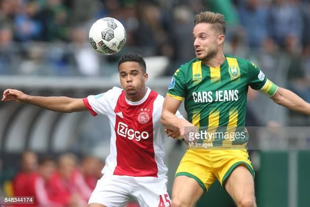 Justin Kluivert of Ajax Aaron Meijers of ADO Den Haag during the Dutch Eredivisie match between ADO Den Haag and Ajax Amsterdam at Car Jeans stadium...