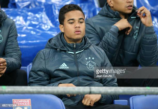 Justin Kluivert of Ajax Amsterdam looks on from the bench during the UEFA Europa League semi final second leg match between Olympique Lyonnais and...