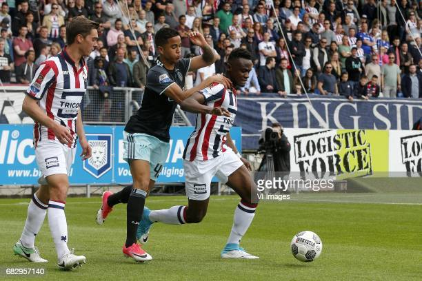 Justin Kluivert of Ajax Asumah Abubakar of Willem II during the Dutch Eredivisie match between Willem II Tilburg and Ajax Amsterdam at Koning Willem...