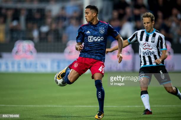 Justin Kluivert of Ajax Bart van Hintum of Heracles Almelo during the Dutch Eredivisie match between Heracles Almelo and Ajax Amsterdam at Polman...