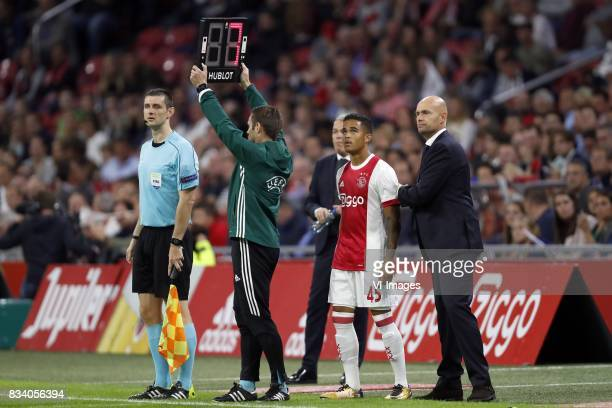Justin Kluivert of Ajax coach Marcel Keizer of Ajax during the UEFA Europa League fourth round qualifying first leg match between Ajax Amsterdam and...