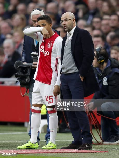 Justin Kluivert of Ajax coach Peter Bosz of Ajaxduring the Dutch Eredivisie match between Ajax Amsterdam and FC Twente Enschede at the Amsterdam...