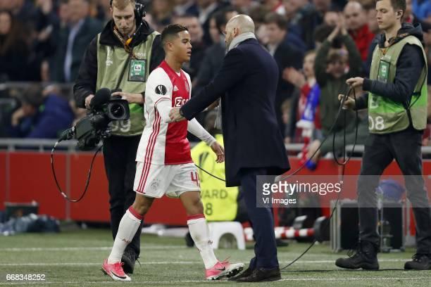 Justin Kluivert of Ajax coach Peter Bosz of Ajaxduring the UEFA Europa League quarter final match between Ajax Amsterdam and FC Schalke 04 at the...