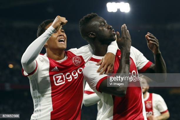 Justin Kluivert of Ajax Davinson Sanchez of Ajax during the UEFA Champions League third round qualifying first leg match between Ajax Amsterdam and...