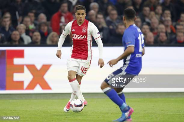 Justin Kluivert of Ajax Dennis Aogo of FC Schalke 04during the UEFA Europa League quarter final match between Ajax Amsterdam and FC Schalke 04 at the...