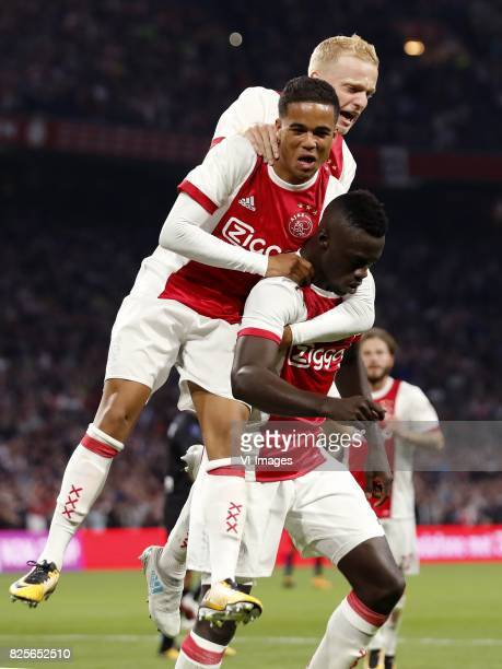 Justin Kluivert of Ajax Donny van de Beek of Ajax Davinson Sanchez of Ajax during the UEFA Champions League third round qualifying first leg match...
