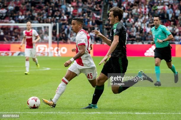 Justin Kluivert of Ajax Etienne Reijnen of FC Groningen during the Dutch Eredivisie match between Ajax Amsterdam and FC Groningen at the Amsterdam...