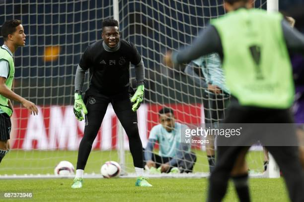 Justin Kluivert of Ajax goalkeeper Andre Onana of Ajaxduring a training session prior to the UEFA Europa League final match between Ajax Amsterdam...