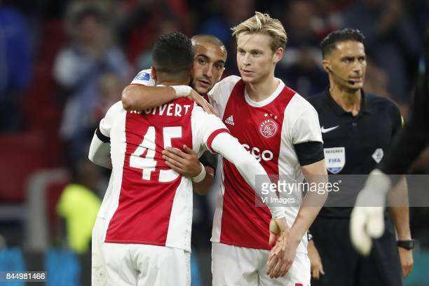 Justin Kluivert of Ajax Hakim Ziyech of Ajax Frenkie de Jong of Ajax referee Serdar Gozubuyuk during the Dutch Eredivisie match between Ajax...