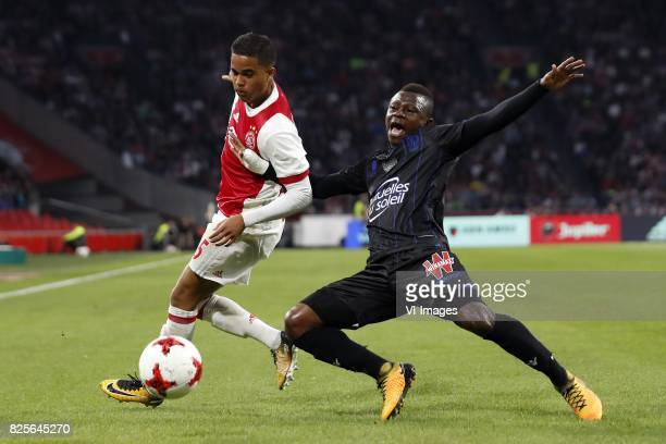 Justin Kluivert of Ajax Jean Michel Seri of OCG Nice during the UEFA Champions League third round qualifying first leg match between Ajax Amsterdam...